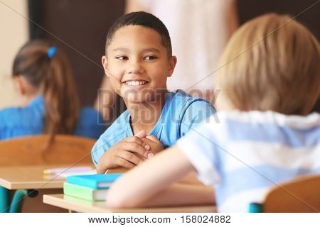 African American boy on lesson in classroom