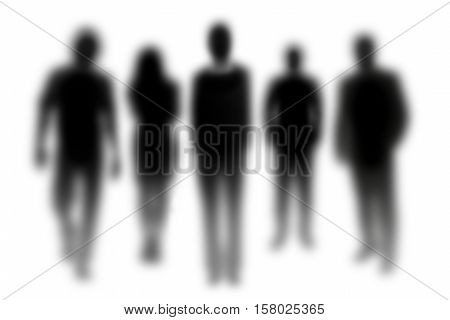 Group of out of focus silhouettes of people