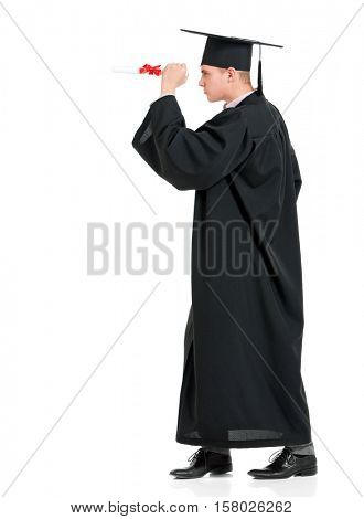 Portrait of man in an academic gown holding a diploma, isolated on white background