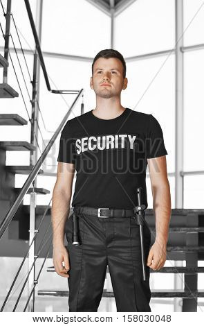 Security man standing beside stairs
