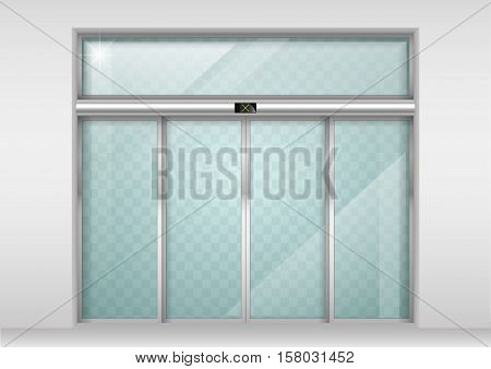 Double sliding glass doors with automatic motion sensor. Entrance to the office train station supermarket.