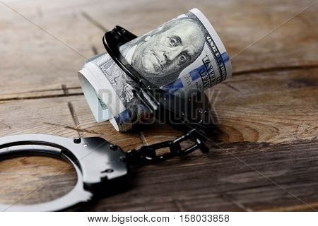 Money In Handcuffs. Security Concept