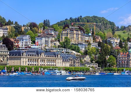 Lucerne, Switzerland - 8 May, 2016: buildings along Lake Lucerne, people in boats and on the embankment of the lake. Lucerne is a city in central Switzerland, it is the capital of the Swiss Canton of Lucerne.