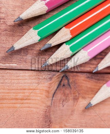 Wooden colorful pencils with sharpening shavings. School and office supplies