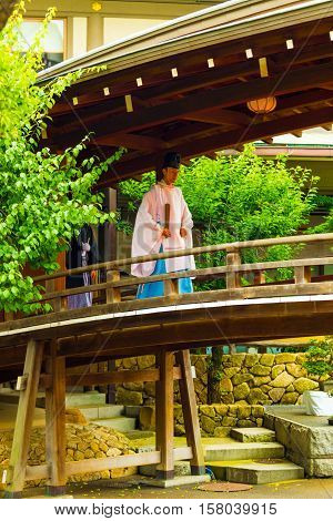 Shinto Priest Kannushi Robe Walking Wooden Bridge