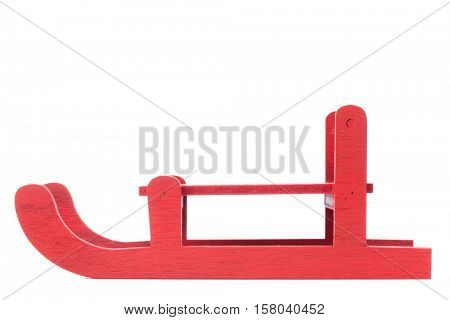 Side view of red wooden sled, isolated on white background