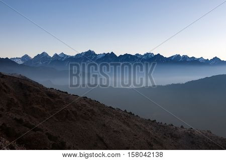 Misty Mountain Early Morning Landscape In Himalayas, Nepal. Blue Hour Misty Mountains Scenery With H