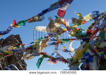 Waving Multicolored Buddhist Prayer Flags On Renjo La Pass On Three Passes Trail Route In Himalayas,