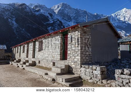 Remote School In Himalayan Village Of Thame, Sagarmatha National Park, Nepal. Nepali House Made Of S