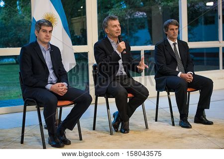 Olivos, Argentina - May 6, 2016: President of Argentina Mauricio Macri C, Finance Minister Alfonso Prat-Gay R and Cabinet Chief Marcos Pena L during a press conference at the presidential residence