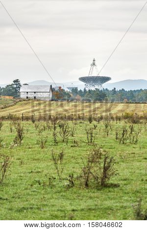 Rural West Virginia farm scenery with Green Bank radio Telescope in distance