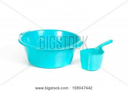 Plastic Ladle Near A Basin