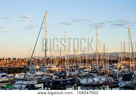 Many boats on marina during sunset with mountains in Oxnard, California