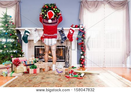 Father Decorating The Living Room For Christmas