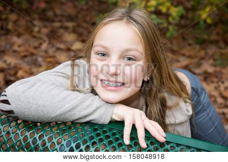 Blond Girl Preteen Smiling With Dental Braces