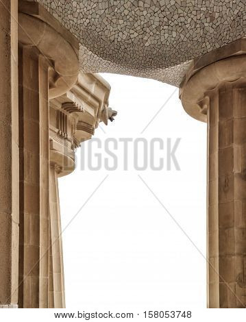Isolated on white. Doric columns of Hypostyle Room support lower court central terrace. Park Guell in Barcelona.