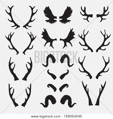 Vector Horns set silhouette on the grunge hipster background. Grunge effect isolated objects.