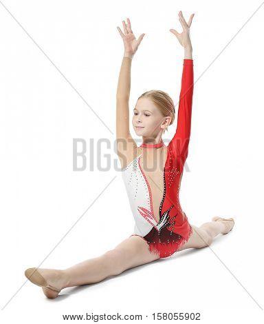 Young girl doing gymnastics, isolated on white