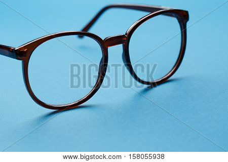 Glasses close-up on blue background