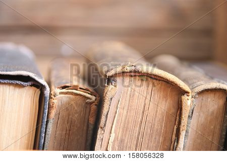 Vintage, antiquarian books books on old wooden shelf.