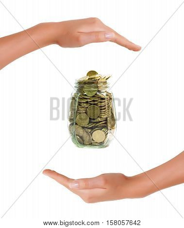 Euro coins in a jar between hands on white background concept of saving money and protection of investment