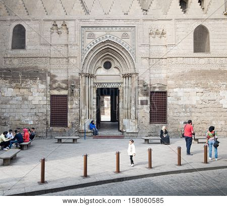 Cairo, Egypt - November 19, 2016: Entrance of theological school and Mausoleum of Sultan Qalawun, Moez Street