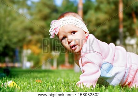 Little girl playing outdoors in the park