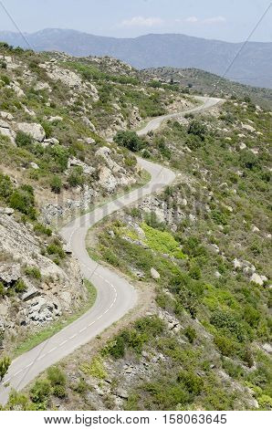 several curves on mountain road without cars