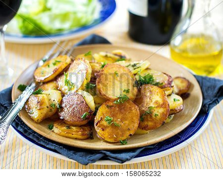 Fried potatoes with goose duck grease garlic and parsley