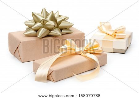 Set Of Three Of Gift Boxes With Presents Wrapped In Kraft Paper And With Golden Light Beige Bow And