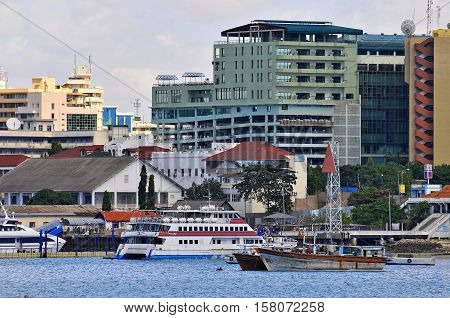 DAR ES SALAAM TANZANIA - NOVEMBER 15 2015: Architecture in downtown of Dar es Salaam Tanzania East Africa in the evening at sunset. Horizontal orientation wide angle.