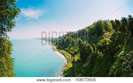 Beautiful Scenic Summer View From Botanical Garden Of Sea Bay And Railroad On Coast. The Lush Green Vegetation Of Summer. Sunny Day. Batumi, Adjara Georgia. Panorama