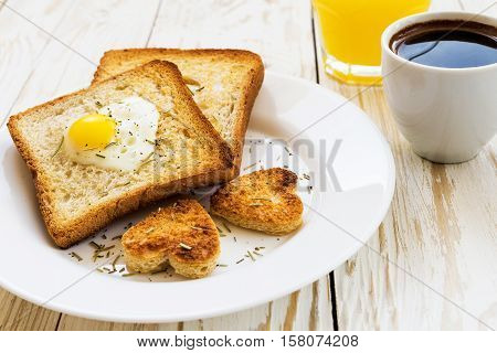 Egg Fried In A Heart-shaped Toast Cutout Sprinkled
