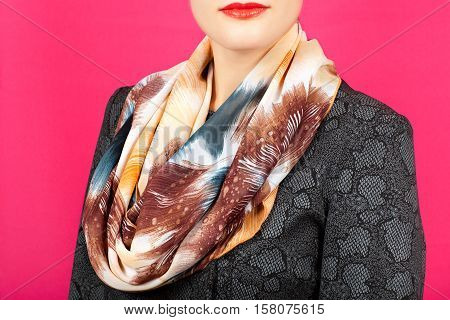 Silk Scarf. Beige Silk Scarf Around Her Neck Isolated On Pink Background.