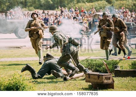 Gomel, Belarus - May 9, 2016: The Scene Of Reenactment Of The Battle Of WW2: Soviet Armed Forces Against Wehrmacht Soldiers Reenactors On Celebrating Victory Day 9 May