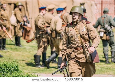 Gomel, Belarus - May 9, 2016: The Reenactor In Soldiers Uniform Of Soviet Armed Forces Moving With Gun. Historical Reenactment Of WW2 Time On Celebrating Victory Day 9 May.