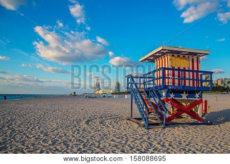 Lifeguard tower in South Beach, Miami with the colors of the american flag