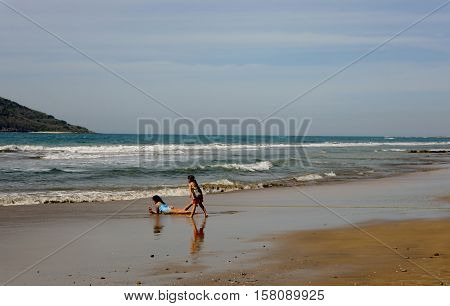 Children playing on a beach in Mazatlan, Mexico.