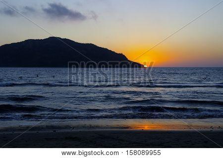 Sunset behind Deer Island from Las Gaviotas beach in Mazatlan,Mexico.