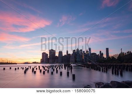 Golden hour in Brooklyn New York looking at a Brooklyn dock on the left and lower Manhattan on the right