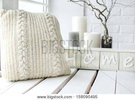 decor for the house bright colors knitted pillow candle light wooden window sill