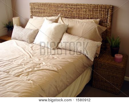 Bedroom With Cane Bedhead