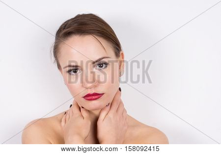 Young woman face, shoulders and hands