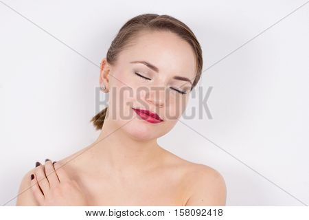 Young woman face, shoulders and closing eyes