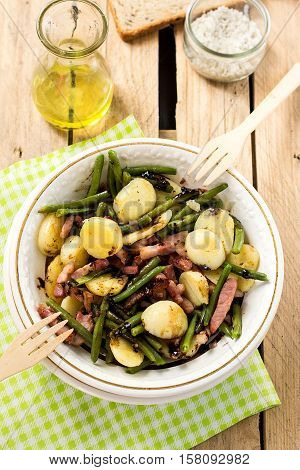 Warm potato salad with green beans bacon and balsamic dressing
