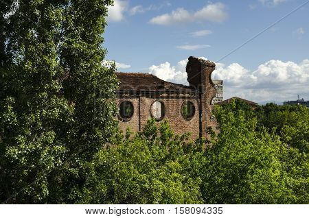 Abandoned old sugar factory and new town behind