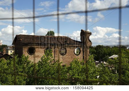 Abandoned ex sugar factory in suburban. Loneliness