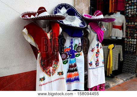 Clothing for sale on a street in Taxco, Mexico.