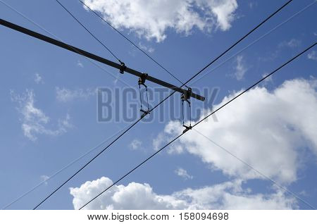 Blue sky and trolley bus electric wires