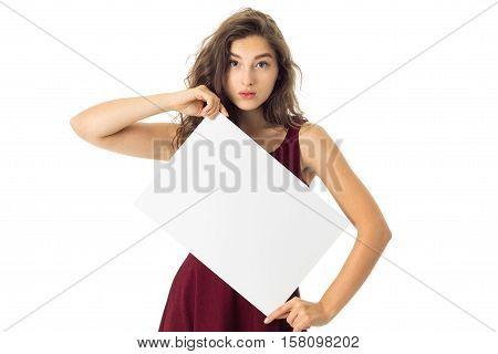 young adorable brunette girl in red dress with white placard in hands isolated